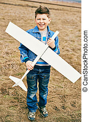 Child with airplane