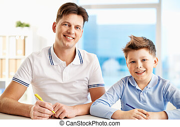 Parent and child - Photo of happy man and his son with pens...