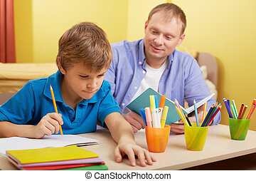 Doing schoolwork at home - Portrait of cute schoolboy and...