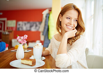 Sweet moment - Image of young female enjoying dessert in...