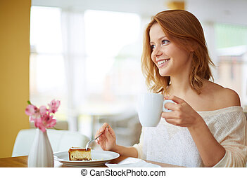 Eating dessert - Image of young and pretty woman having...