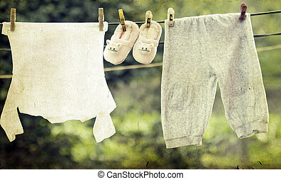 Baby clothes hanging on the clothesline - Small Baby clothes...