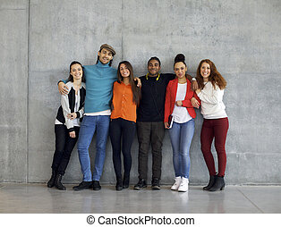 Multiethnic group of happy young university students on...