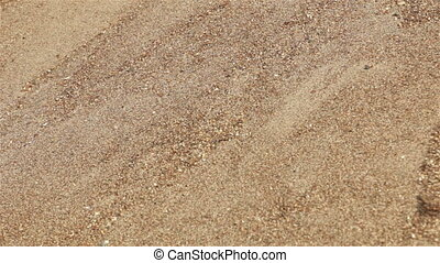 Sands on slope falling down. Close-up view background