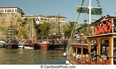 Tourists returning to harbor after a sea voyage on the...