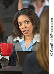 Concerned Woman with Coffee - Concerned young business woman...