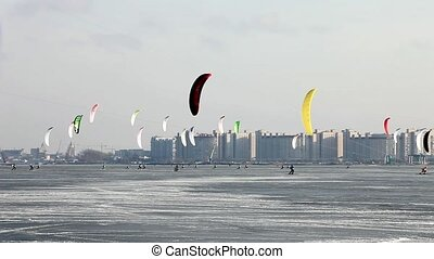 colorful snowkiting  - sailing in the winter  snowkiting