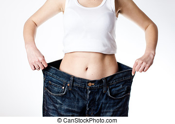 Successful Weight Loss - Slim waist of young woman in big...