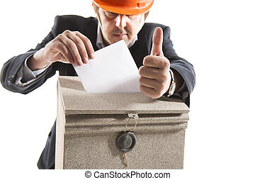 Worker putting letter in mailbox,showing thumbs up gesture -...