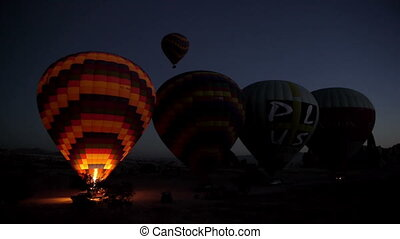Hot-air balloons are inflated with hot air before the flight...