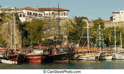 Several old style wooden ships moored in old harbor in...