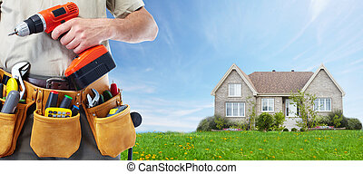 Worker with a tool belt. Construction and house renovation...