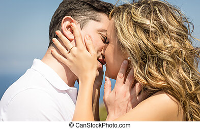 Passionate love couple kissing on a summer day - Passionate...