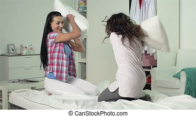 Pillow Fight - Slow motion of girls pillow fighting