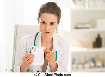 Medical doctor woman pointing on prescription