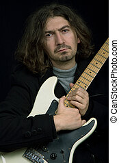 rocker - young rocker in studio picture, closeup portrait