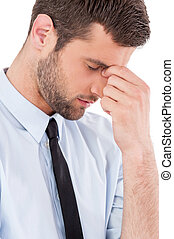 Feeling exhausted. Side view of young man in shirt and tie...