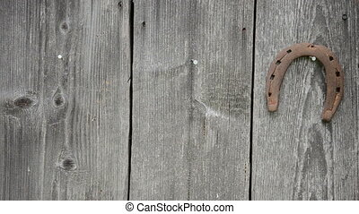 rusty horse shoe hang - Rusty horse shoe hanging on wooden...