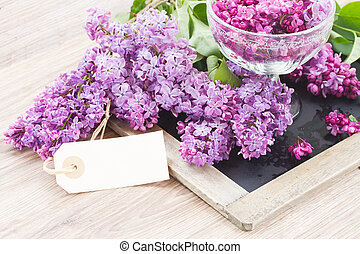 Lilac on table with empty tag