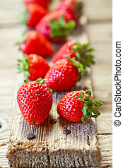 fresh strawberries closeup on wooden board