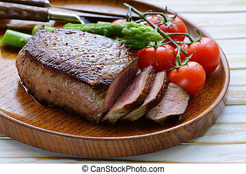 grilled meat beef steak with vegetable garnish asparagus and...