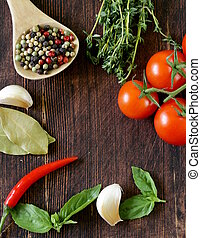 Spices, herbs and vegetables on a wooden background