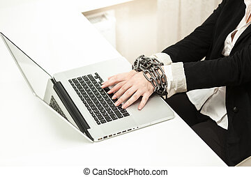 chained businesswoman typing on keyboard - Photo of chained...