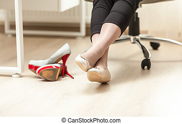 photo of female feet in ballet in office - Closeup photo of...