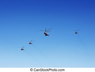 Transport helicopters in flight - Group of modern militar...