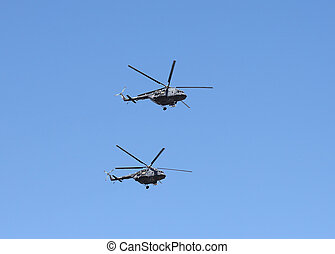 Helicopters in flight - Two of modern militar helicopters on...