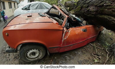 Side view of crashed car's cabin of retro car called...