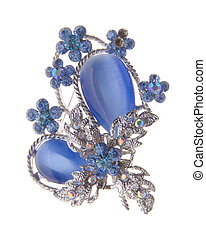 brooch with different gems on background. - brooch with...