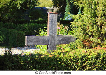 Simple wooden cross at an old graveyard in Denmark