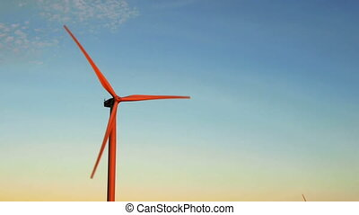 Wind turbine for alternative energy at sunset