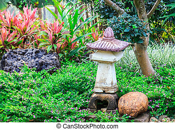 Japanese style garden with stone lantern in the park