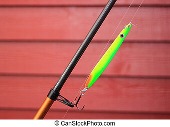 Green neon fishing hook on a fishing rod