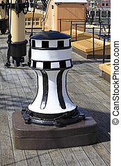 Old Ships Capstan - Old sailing ships capstan on a wooden...