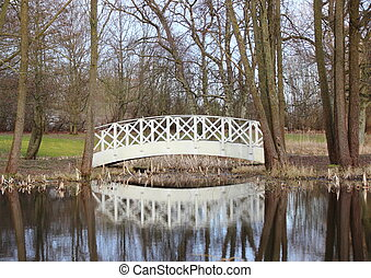 White bridge at small pond in park