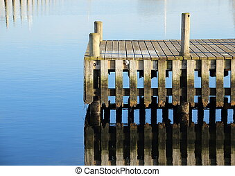 Bathing jetty and landing stage for boats with water...