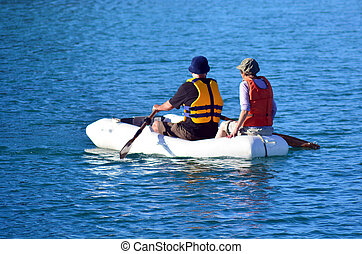 Couple rows dinghy boat