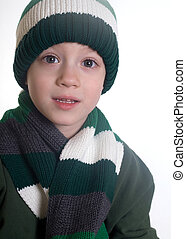 Keeping warm - Small boy wearing a knit cap and scarf