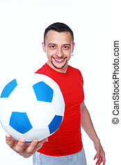 Happy sportive man holding soccer ball over white background