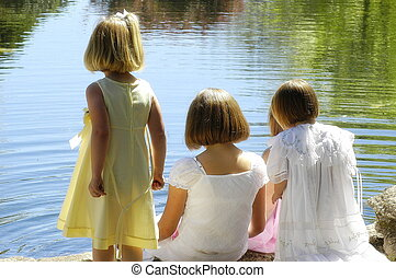 sisters - 4 young girls looking into lake