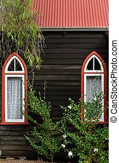 The Eyes of the Lord - Two pointed arch windows in dark...