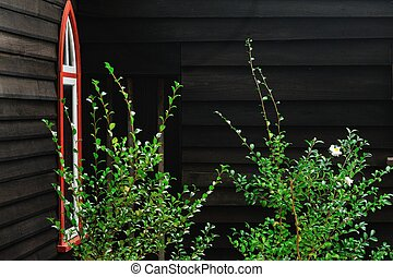 The Garden of the Lord - Corner of dark weatherboard curch...