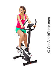 Young woman uses stationary bicycle trainer