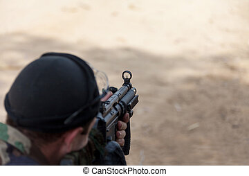 terrorist holding at gunpoint, the military conflict