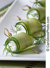 Cucumber rolls with cream cheese and dill vertical -...