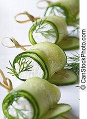 appetizing useful rolls fresh cucumber with soft cheese on...