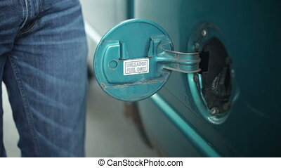 Filling up gas tank - Filling up car gas tank with fuel at...